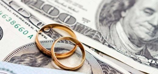 depositphotos_26642323-stock-photo-wedding-rings-lie-on-money